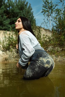 #484 - Brunette Girl in Wet and Dirty Levis Jeans Has Fun by the Lake