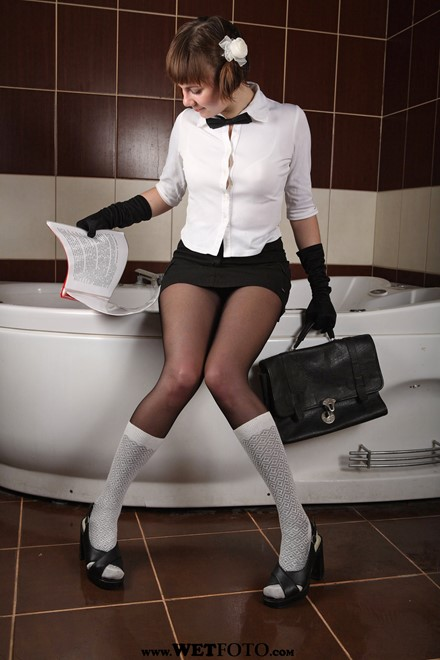 wet girl get wet wet hair fully clothed shirt skirt tights knee socks shoes high heels bath