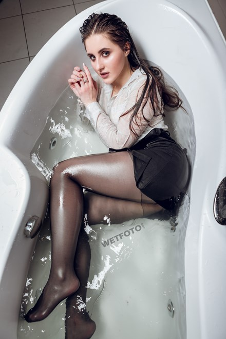 wetfoto pretty woman business suit takes shower and get wet