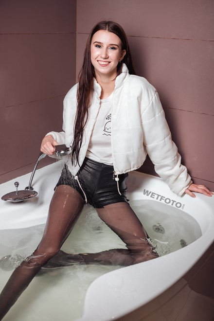 wetfoto wetlook wet girl leather shorts black tights