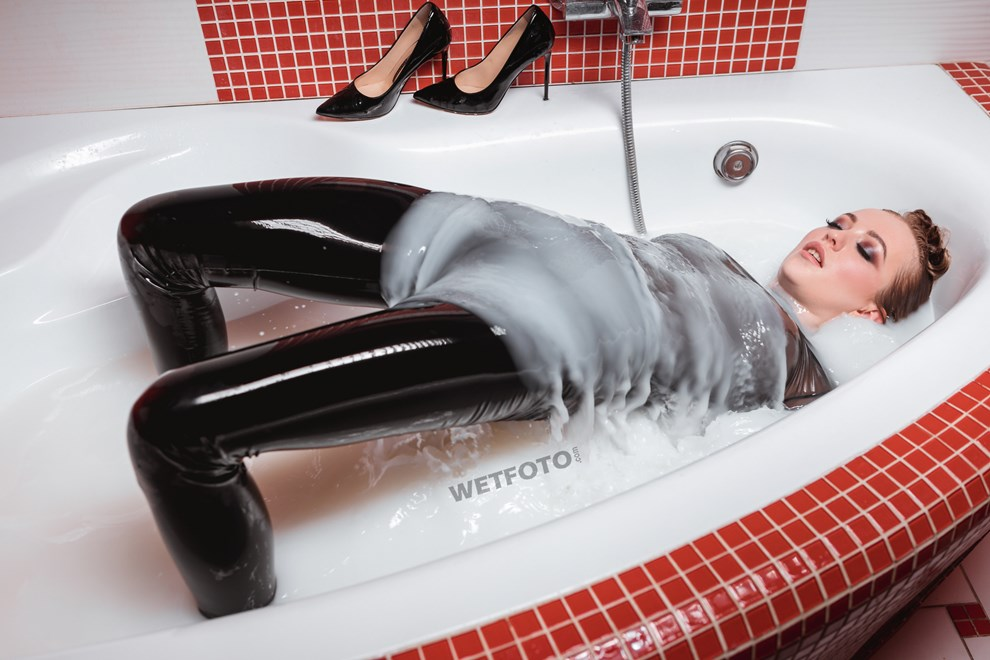 wetfoto wet girl black vinyl leggings takes milk bath