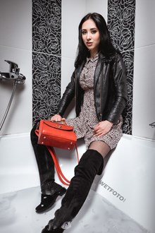 #499 - Brunette Girl Dressed in Pantyhose, Cute Dress and Boots Gets Soaking Wet in Bath