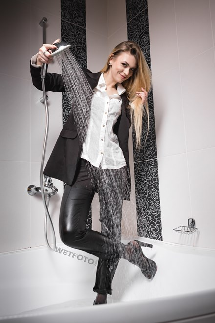 wetfoto girl takes bath business suit skinny jeans