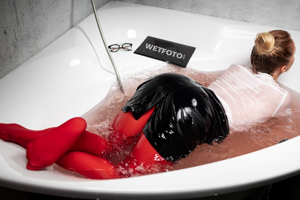 wetlook business woman soaked takes bath red suit pantyhose