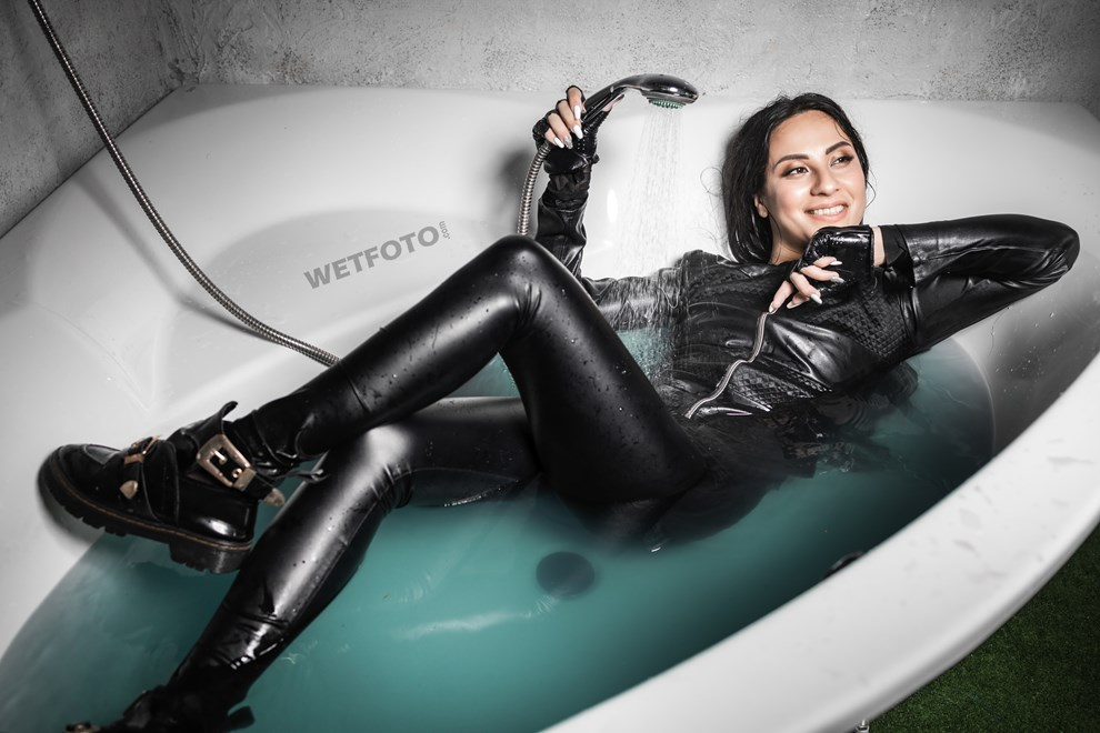 fully clothed girl gets completely wet bath shiny leggings