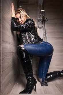 #538 - Hot Woman Takes a Shower and Lies in the Water in Tight Blue Jeans and High Heels Boots