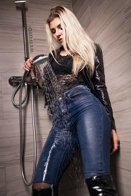blonde girl takes bath shower fully clothed wetfoto