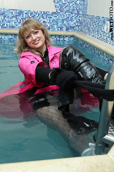 wet woman get wet fully clothed coat stockings blouse shorts scarf gloves boots leather pool