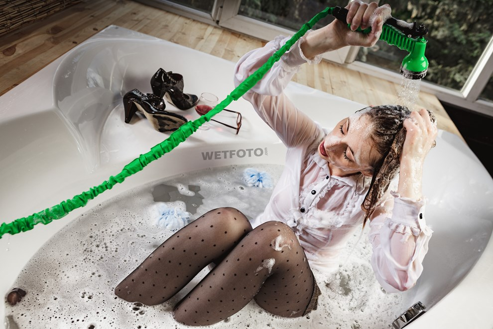 wetfoto girl business attire nylons skirt takes bath shampoos hair