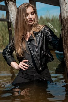 #560 - Wetlook Photosession with Hot Long-haired Girl in Wet Super Skinny Jeans, Tights and Bodysuit