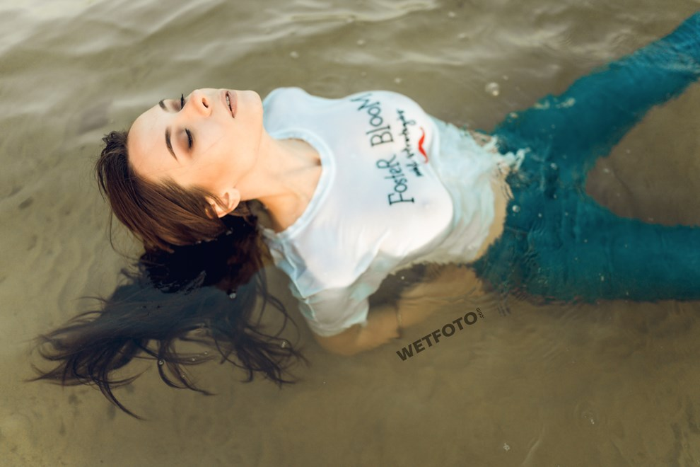 girl swims clothed skinny jeans t shirt socks wetfoto