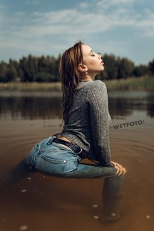 #568 - Wetlook Video with Hot Fully Clothed Girl in Wet Skinny Jeans and Sneakers