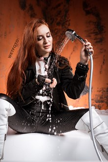 #571 - Hot Wetlook Girl in Wet Faux Leather Pants and White Boots