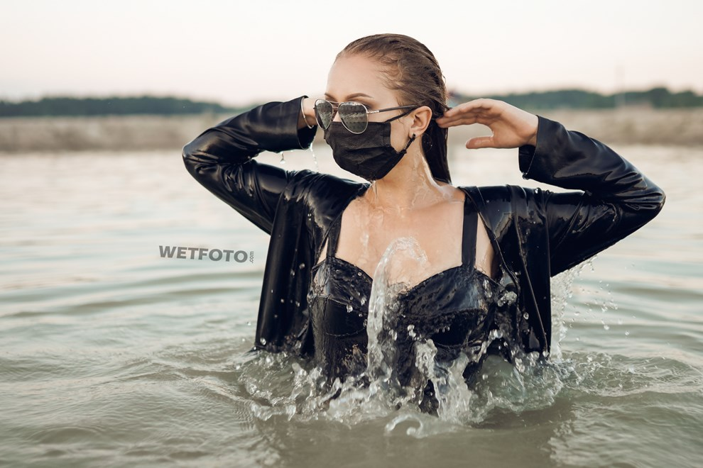 girl swims in lake business suit nylons