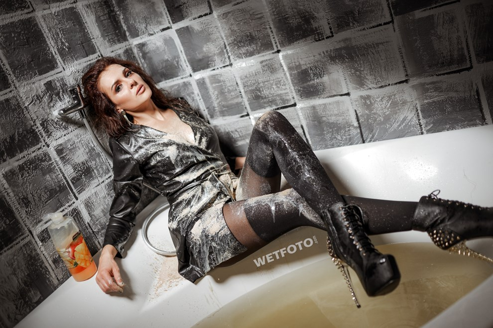 sexy lady takes bath gets wet leather dress shoes tights wetfoto