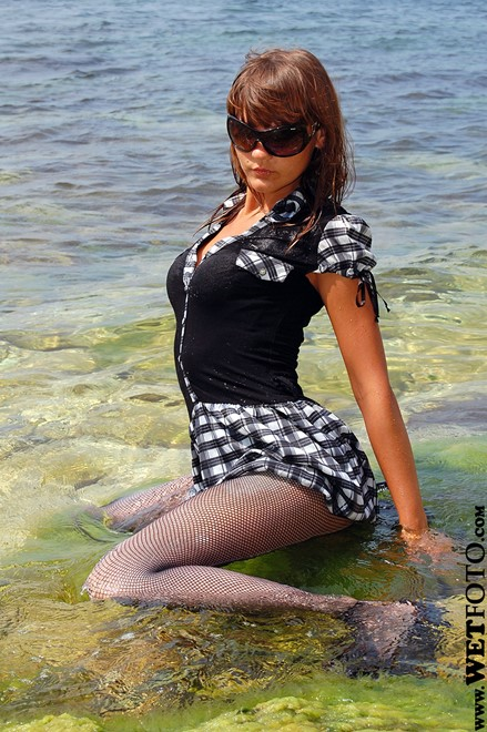 wet girl get wet wet hair fully clothed dress stockings sexy high heels shoes sea