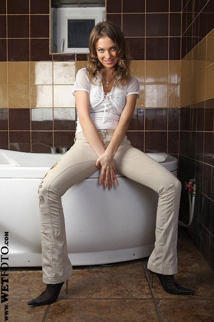 wet girl get wet wet hair fully clothed pants blouse high heels bath