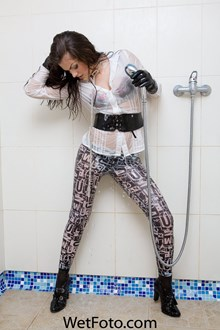 #72 - Wetlook by Sexy Woman in White Shirt, Leggings, Leather Gloves, Belt and High Heels