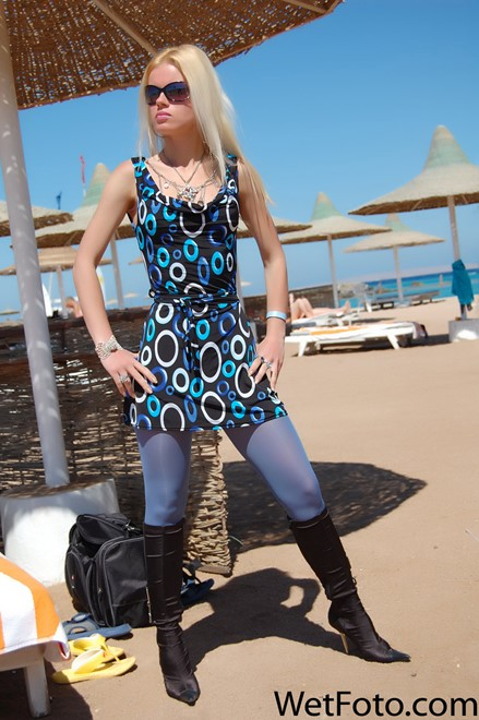 wet girl get wet wet hair fully clothed dress stockings boots sea