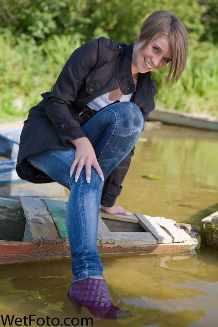 wet girl get wet wet hair fully clothed cloak jeans t-shirt shoes lake