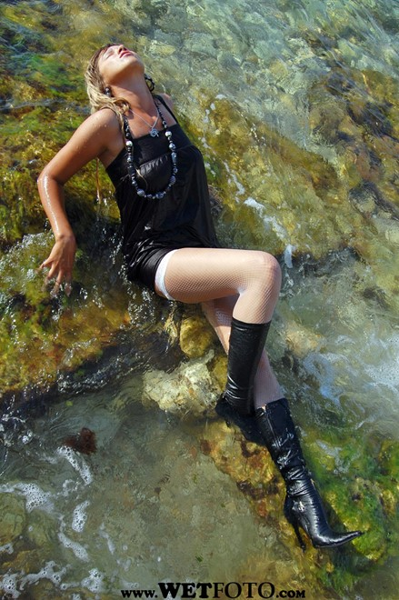 wet girl wet hair get wet swim fully clothed tunic fishnet tights high heels boots fully soaked sea