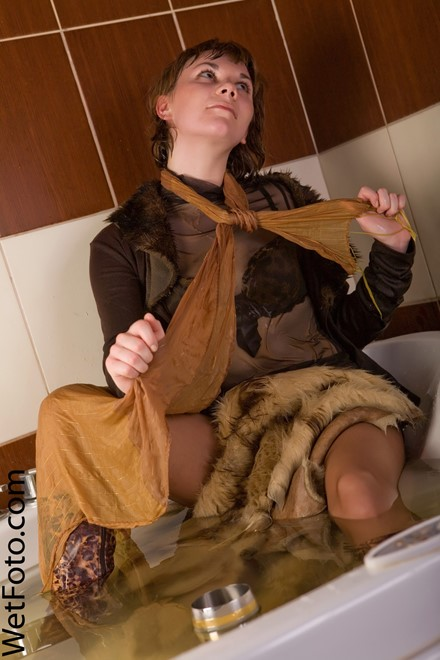 wet woman get wet wet hair fully clothed sheepskin coat jacket blouse stockings shorts boots jacuzzi bath