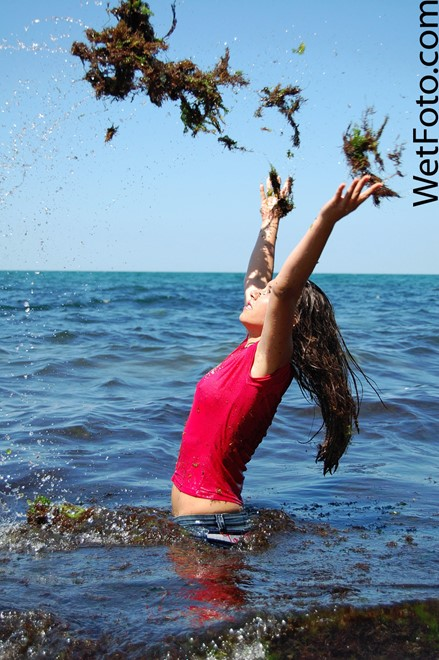 wet girl get wet wet hair swim fully clothed jeans blouse high heels sea