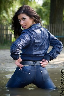 #91 - Wetlook by Beautiful Girl in Jacket, Tight jeans on Shoes with Heels by the River