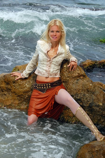 #94 - Wetlook by Tanned Blonde in Jacket, White Stockings, Skirt and Shoes on Sea